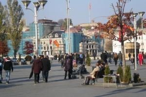 skopje city square, people enjoing the autumn sun