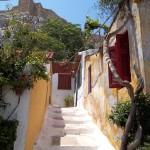 A GREEK ISLAND BELOW ACROPOLIS